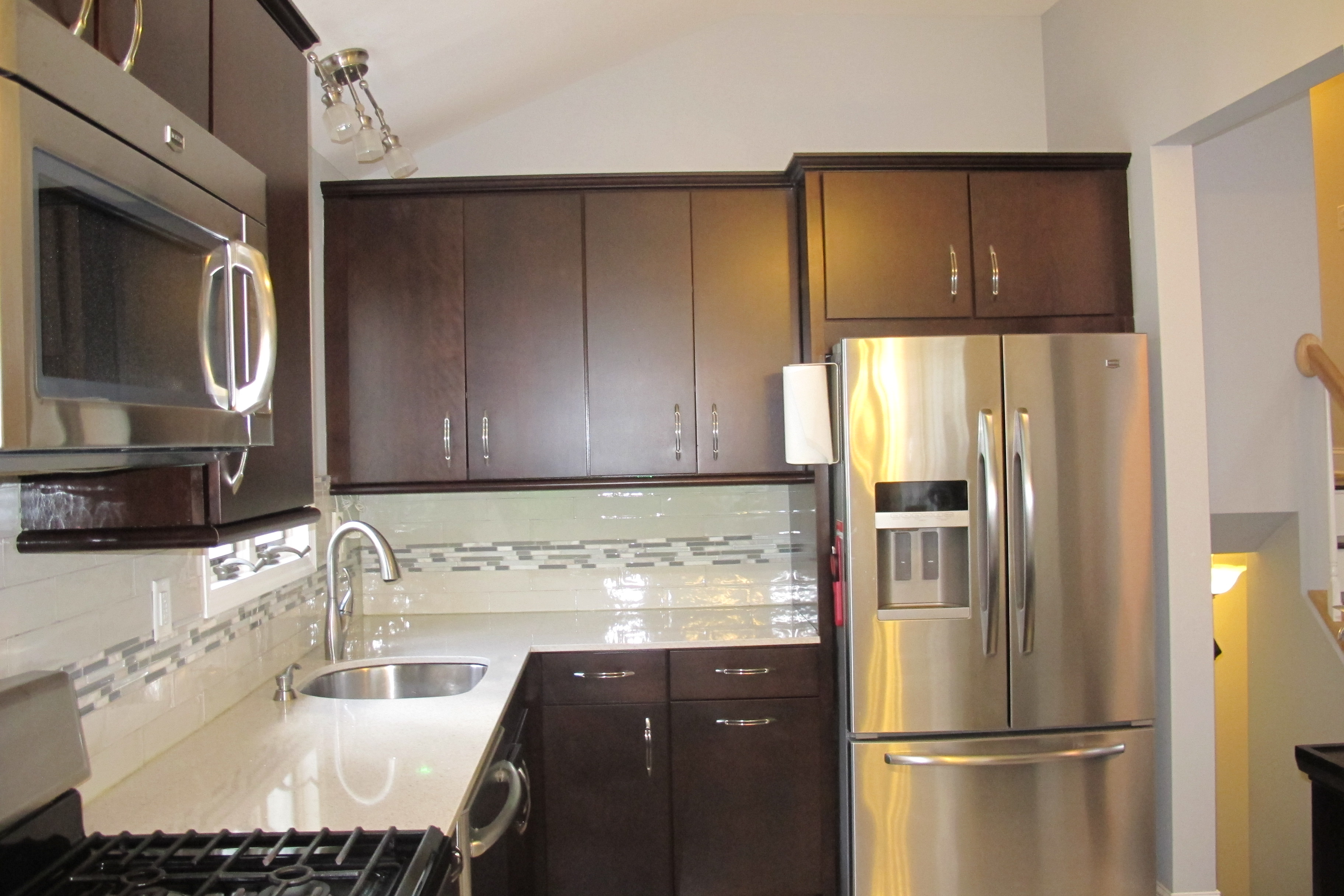 143 commerce kitchen ref view - A.T. REAL Estate Specialists