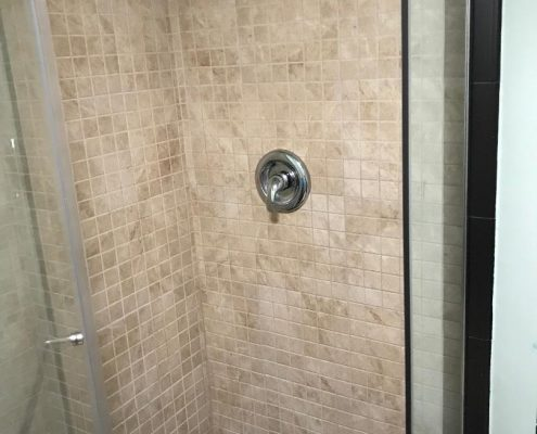 close up shower in basement 67 Ladd