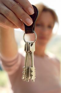 Real Estate Woman holding keys