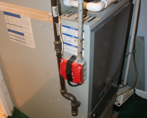 Gas forced air heating system